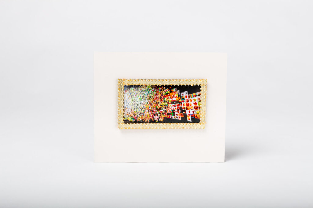 A gilded frame showcasing an image from Trevor Paglen's From 'Apple' to 'Anomaly'
