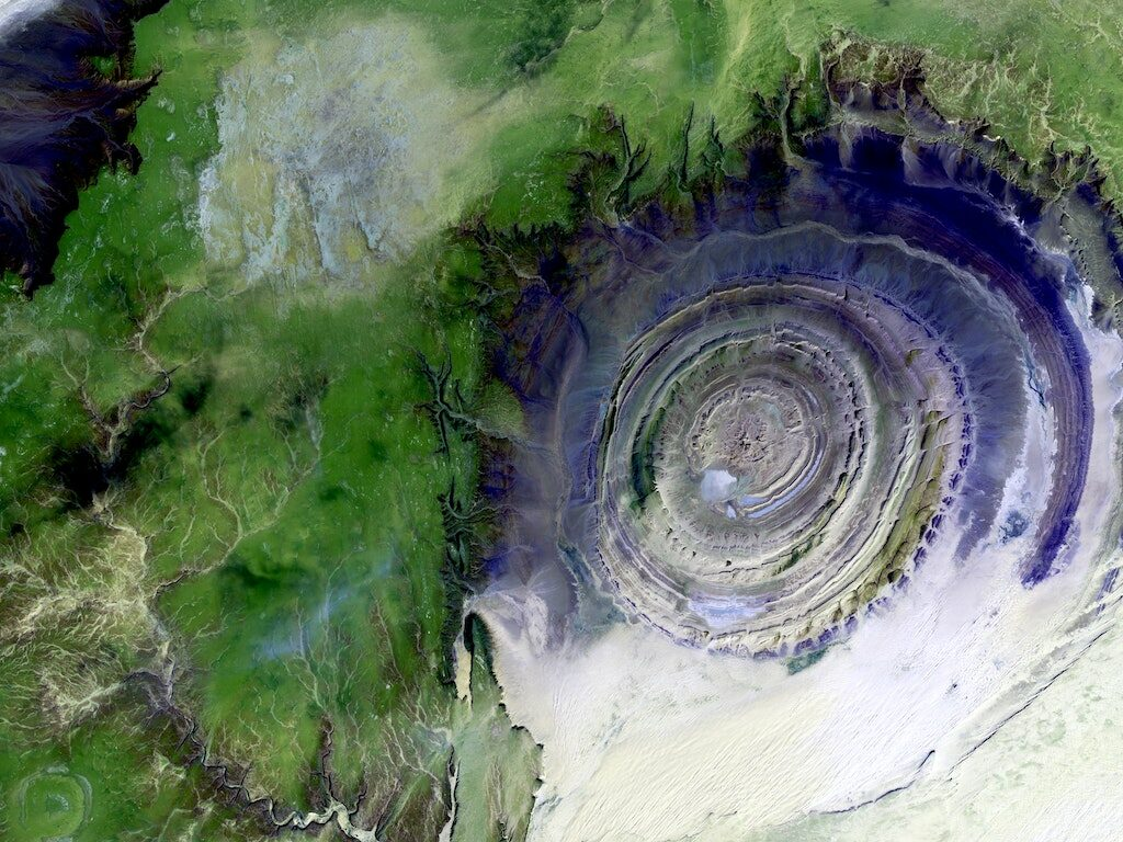 Swirling green and purple view of Maur Adrar Desert from space