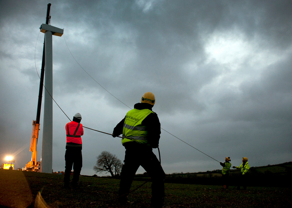 Workers installing a new crowd funded turbine